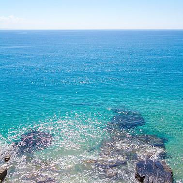 WHERE THE SKY MEETS THE BLUE SEA