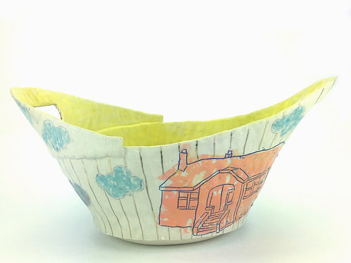 orange house basket with yellow interior