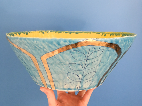 Large turquoise and yellow serving bowl