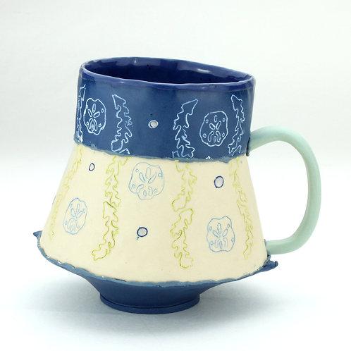 two-toned seaweed and sand dollar mug