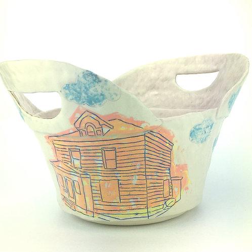 orange house basket with pink interior