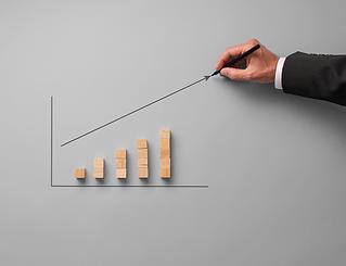 businessman-drawing-financial-graph-NDXY