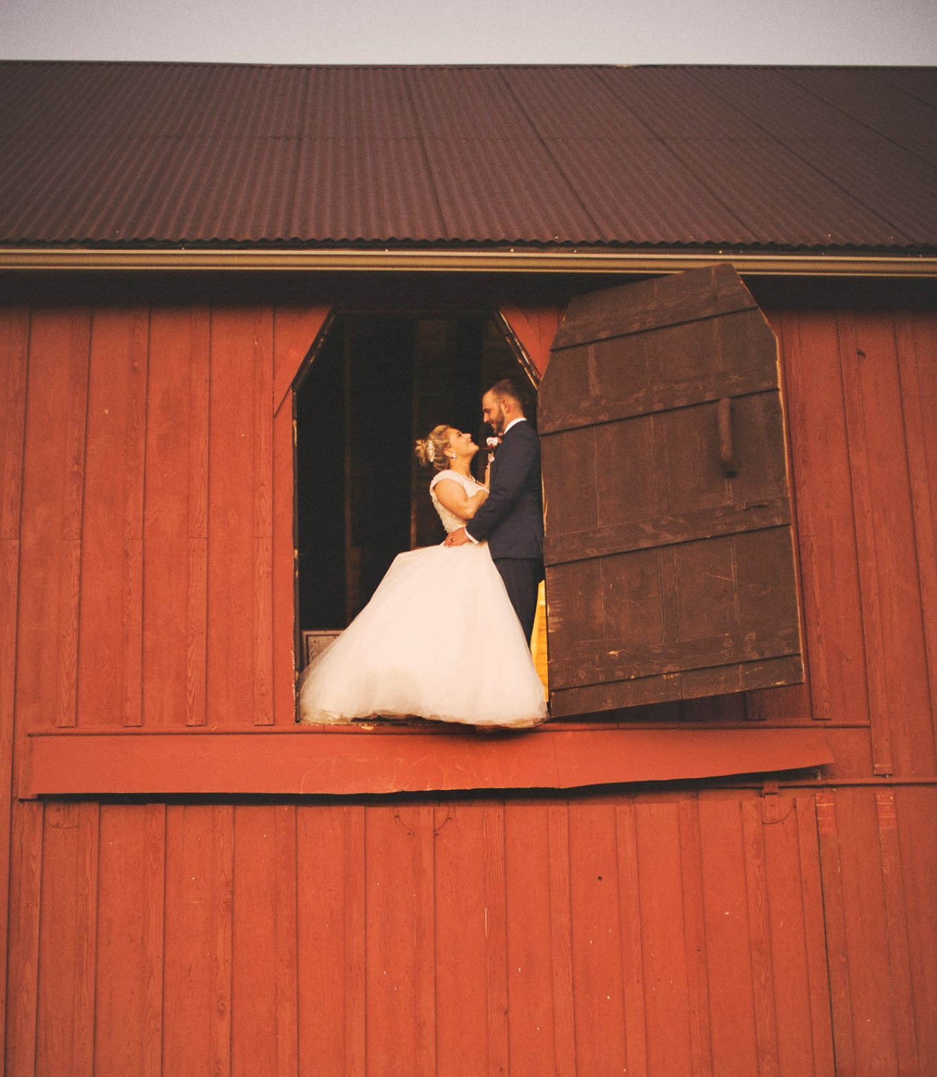 Couple in upstairs barn door