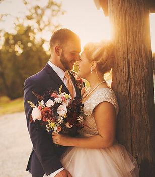 Couple around barn k&m.jpg