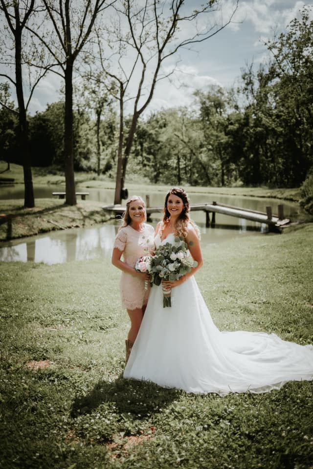 bride and friend at pond