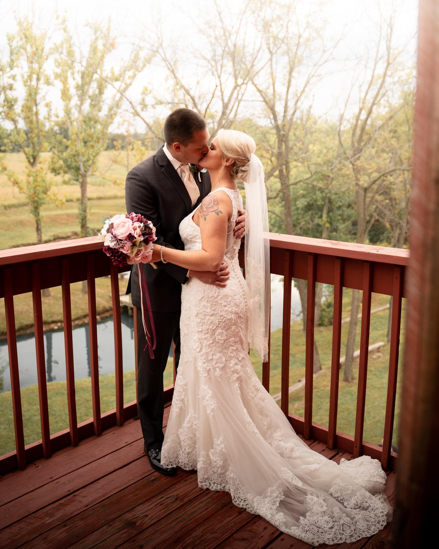 Couple on balcony kiss