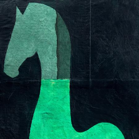 horse in piaffe in green