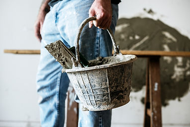 handyman-holding-basket-cement-for-const