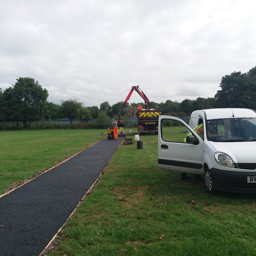 Hilton Main Construction's grab wagon and paver paving new running track at West Midlands school