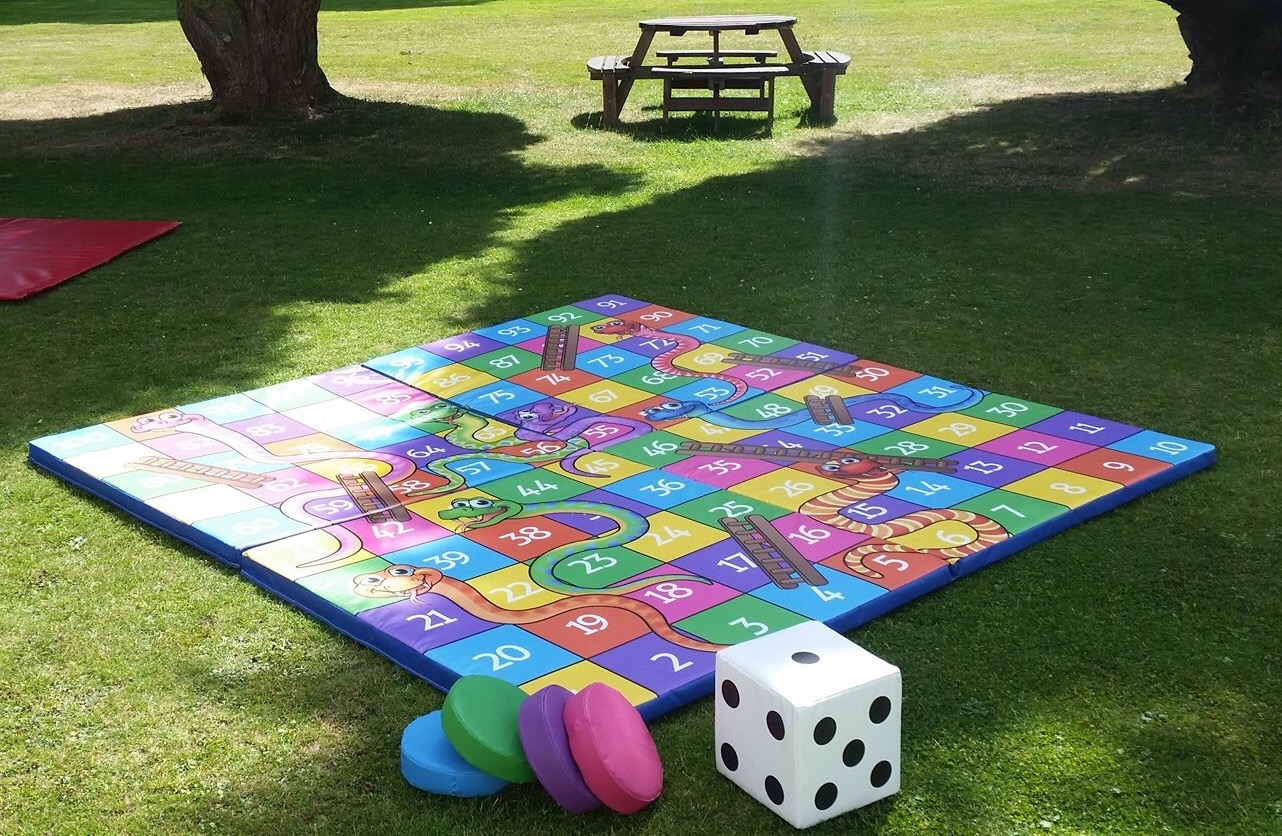 Giant soft snakes & ladders game