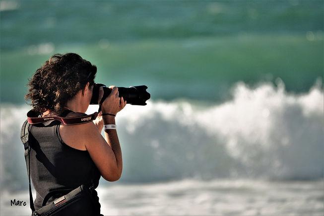 photographe au bord de la mer