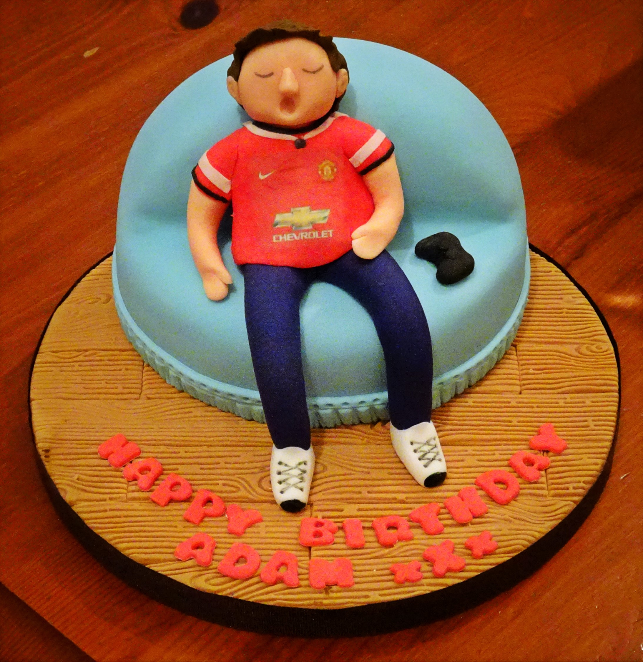 Man U Fan on Couch Cake