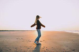 lone woman dance on beach.jpg