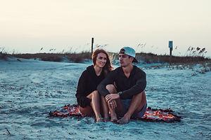 couple sitting on beach.jpg
