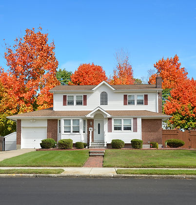 Beautiful Suburban Home residential neighborhood Autumn Season Day Blue Sky.jpg