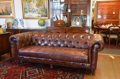 A fine three seater leather Chesterfield. SOLD