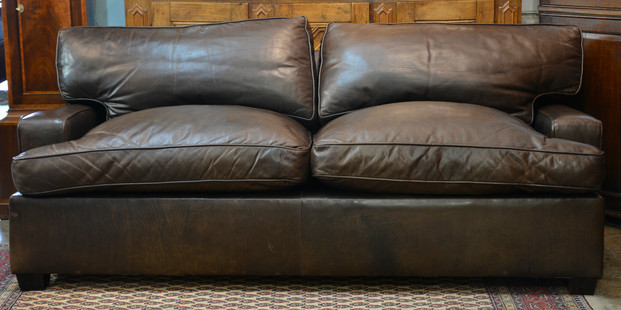 A pair of well worn leather Sofas. R16995 each