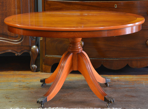 An oval yew wood Side Table. R3695