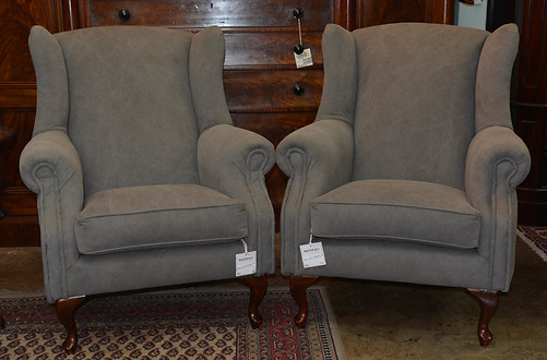 A pair of upholstered Wingback Armchairs. R7995 each