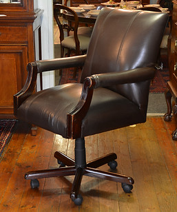 A leather upholstered Executive Chair. R6995