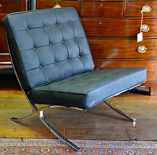 A Barcelona Chair,upholstered in faux leather. R6995