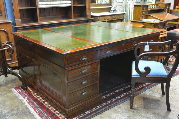 An impressive Edwardian Partner's Desk, with new tooled leather. R36995