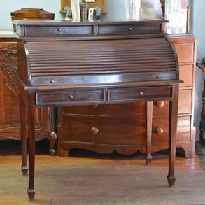 A 20th Century mahogany Roll-top Desk. R8995