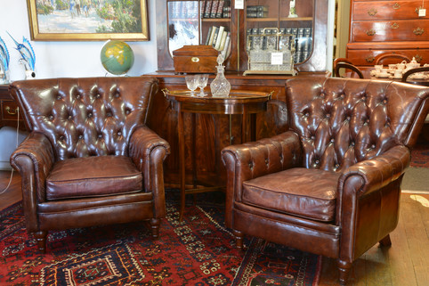 A pair of well worn leather Armchairs, with fantastic patina. SOLD