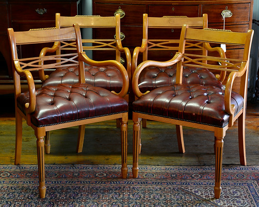 A set of four Yewwood & leather Office Chairs. R3495 each