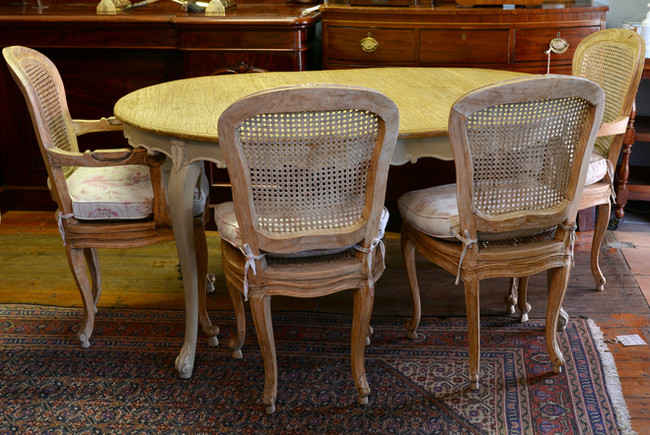 A French Provincial Dining Suite; comprising of two carvers, four side chairs and dining table. R22995