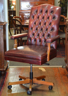 A button-upholstered leather Executive's Chair. R7995