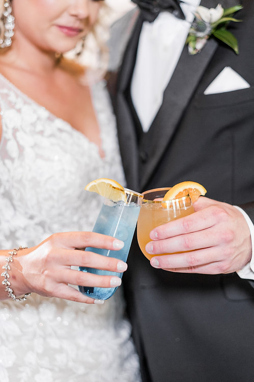 Bride and Groom toasting colorful drinks