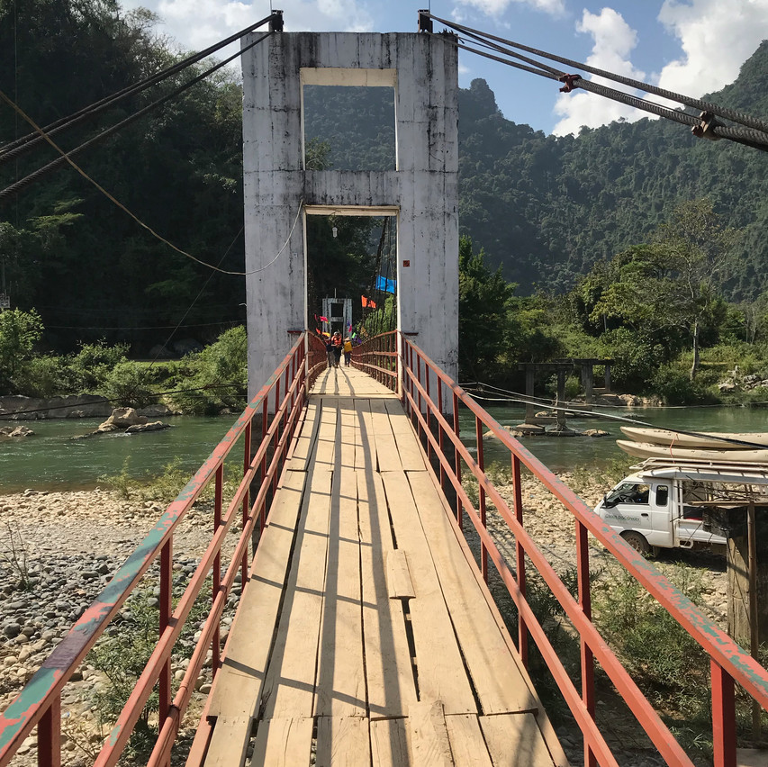 crossing river to access caves