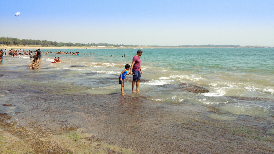 That's me with my 6 year old son in Diu sea beach