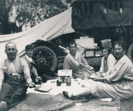 Family group seated on the grass waiting for breakfast, circa 1922, Levin, N.Z.