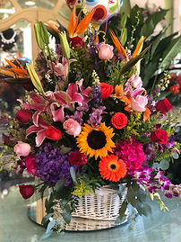 basket with mixed colorful flowers.jpg