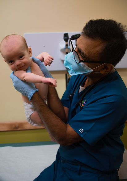 Dr Agarwal with happy baby