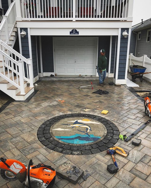 Leaping Marlin installed by Creative Design & Maintenance, LLC. Landscape and Hardscape Construction. Manalapan, NJ