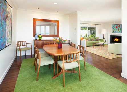 Dining room with mid-century dining room furniture and green rug
