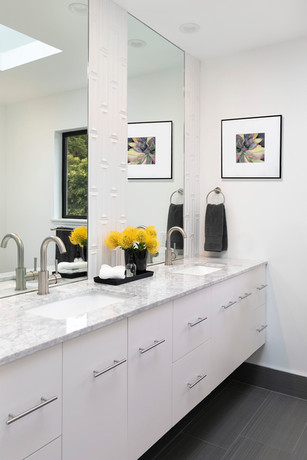 Modern white floating bathroom vanity with geometric wall tile