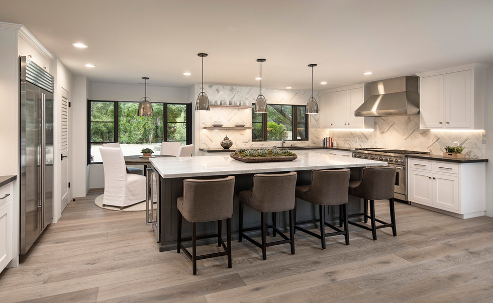 Elegant California Ranch large kitchen with grey island, grey oak floors, pendent lights and eat in breakfast nook in Montecito