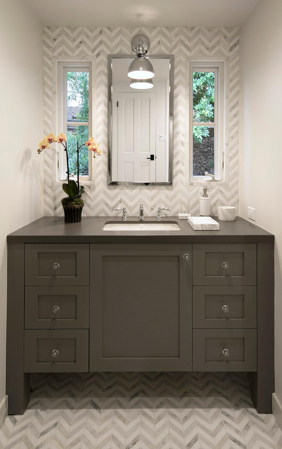 Elegant California Ranch Custom grey bathroom vanity with herringbone floor and wall tile