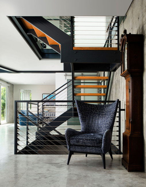 Modern Oasis Steel and wood triple height staircase with modern wing back chair in velevet fabric and antique grandfather clock