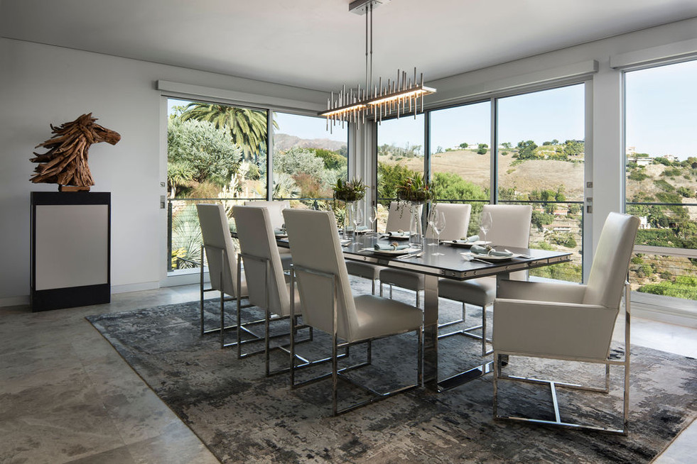 Modern Oasis Modern dining room with glass walls, tile floors, sleigh dining chairs in wite leather