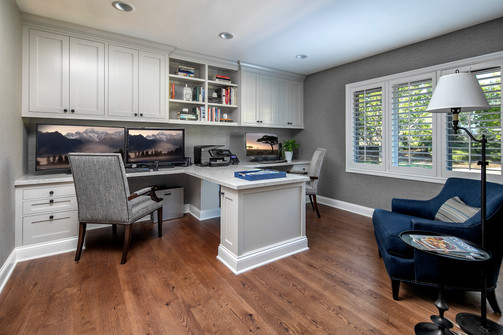 Wine Country Living Home office with two built in workspaces and blue arm chair