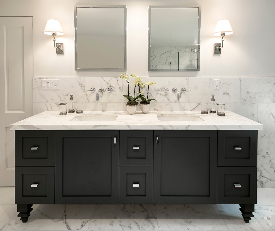 Elegant California Ranch Black custom master bath vanity with two sinks and carerra marble floor and wall tile