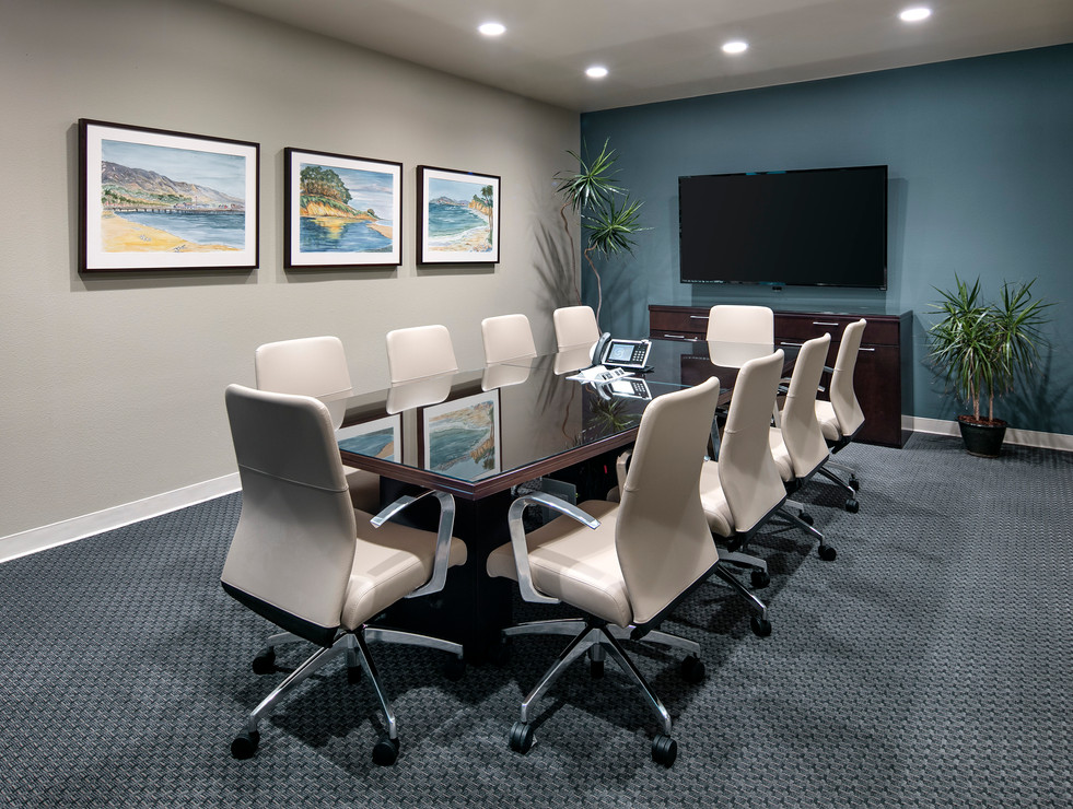 Contemporary Corporate conference room design in Goleta with wood table and blue accent wall