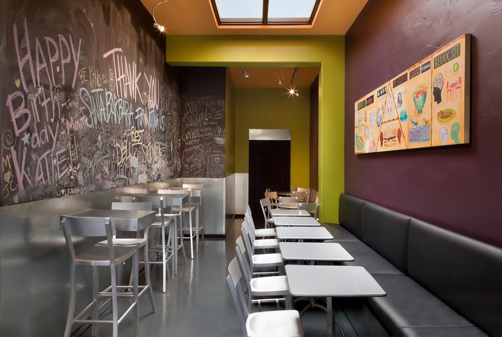 Colorful Deli interior design in Santa Barbara with chalkboard wall and bright painted walls