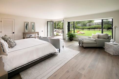 Elegant California Ranch painted white master bedroom with cerused oak flooring