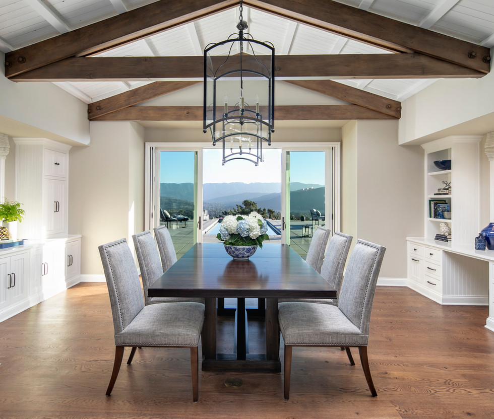 Wine Country Living Dining room interior design with oak wood floors, vaulted beamed ceiling, lantern chandeliers custom dining chairs and table with view of Santa Ynez valley